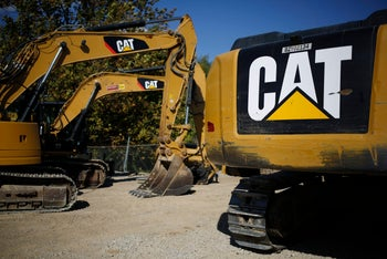 Caterpillar Inc. hydraulic excavators sit at the Whayne Supply Co. dealership in Lexington, Kentucky on October 17, 2016.