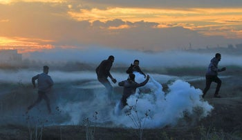 Palestinian protesters clash with Israeli forces on December 11, 2017 near the border fence with Israel, east of Gaza City