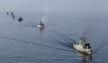 Iranian naval ships take part in a naval parade in the Sea of Oman in southern Iran in 2012.