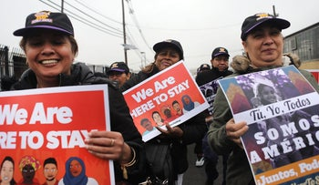 People protest during a rally attended by immigrant residents and activists in Elizabeth, New Jersey, February 23, 2017.