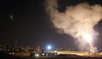 File photo: Israel's Iron Dome missile defense system intercepts a rocket fired from the Gaza Strip toward Israel, 2014.