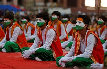 Performers wait for Prime Minister Narendra Modi to address an election campaign meeting ahead of Gujarat state assembly elections, in Ahmedabad, India, December 3, 2017.