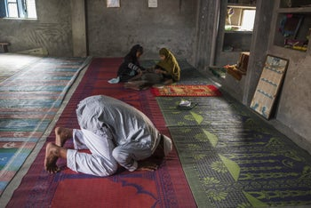 Mohammed Ali Jan Khan, front, prays at a mosque in the the village of Bishara on the outskirts of Dadri, Uttar Pradesh, India, on Thursday, Dec. 10, 2015.