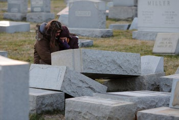 Melanie Steinhardt comforts Becca Richman at the Jewish Mount Carmel Cemetery, February 26, 2017, in Philadelphia, PA. Police say more than 100 tombstones were vandalized a week after a Jewish cemetery in St. Louis was desecrated.