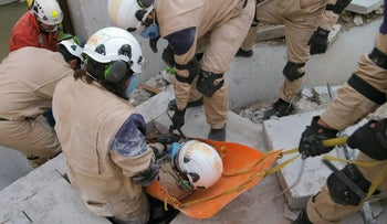"""This image released by Netflix shows a scene from the documentary """"White Helmets."""""""