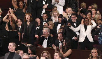 The cast of 'Moonlight' reacts after it turns out the movie won best picture award at the Oscars on Sunday, Feb. 26, 2017.