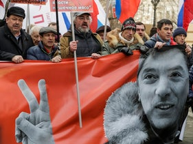 Opposition supporters hold a portrait of Kremlin critic Boris Nemtsov during a rally to mark the anniversary of his murder in Moscow, Russia, February 26, 2017.