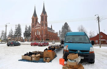 Used items offered for sale in front of the parish church of Saint Stanislaus in Kobylin-Borzymy, eastern Poland, Feb. 13, 2017.