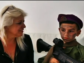 Luna Dayan with her grandson, who is dressed up as Elor Azaria for Purim.
