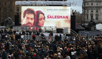 """Crowds gather in London's Trafalgar Square for a public screening of the Iranian film """"The Salesman,"""" February 26, 2017."""