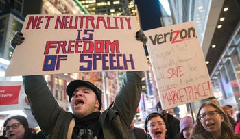 In this Thursday, Dec. 7, 2017, file photo, demonstrators rally in support of net neutrality outside a Verizon store in New York