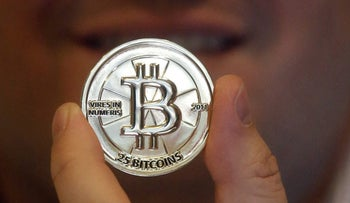 File photo of a 25 Bitcoin token taken in April 3, 2013. As Venezuela's national currency loses value at a catastrophic rate, thousands have begun turning to the world of cryptocurrency.