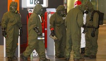 Hazmat crews check for toxic chemicals at the main hall of Kuala Lumpur International Airport in Sepang, Malaysia, February 26, 2017.