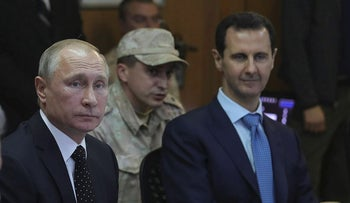 From left, Russian Defence Minister Sergei Shoigu, Russian President Vladimir Putin and Syrian President Bashar Assad attend a meeting at the Hemeimeem air base in Syria, on Monday, Dec. 11, 2017