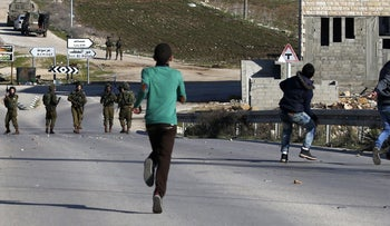 Israeli soldiers and Palestinian stone throwers clash east of Nablus, West Bank, February 2, 2017.