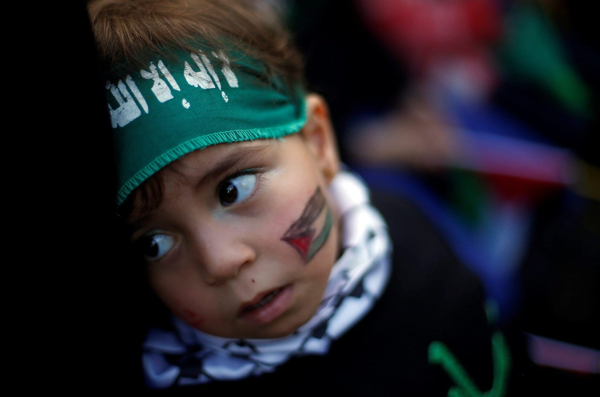 A Palestinian child wearing Hamas headband takes part in a rally marking the 30th anniversary of Hamas' founding, in Gaza City December 14, 2017. R