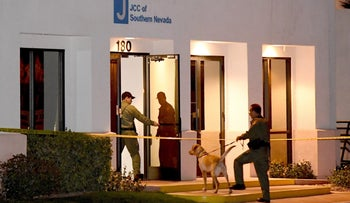 Las Vegas police officers search the Jewish Community Center of Southern Nevada after a bomb threat, February 27, 2017.
