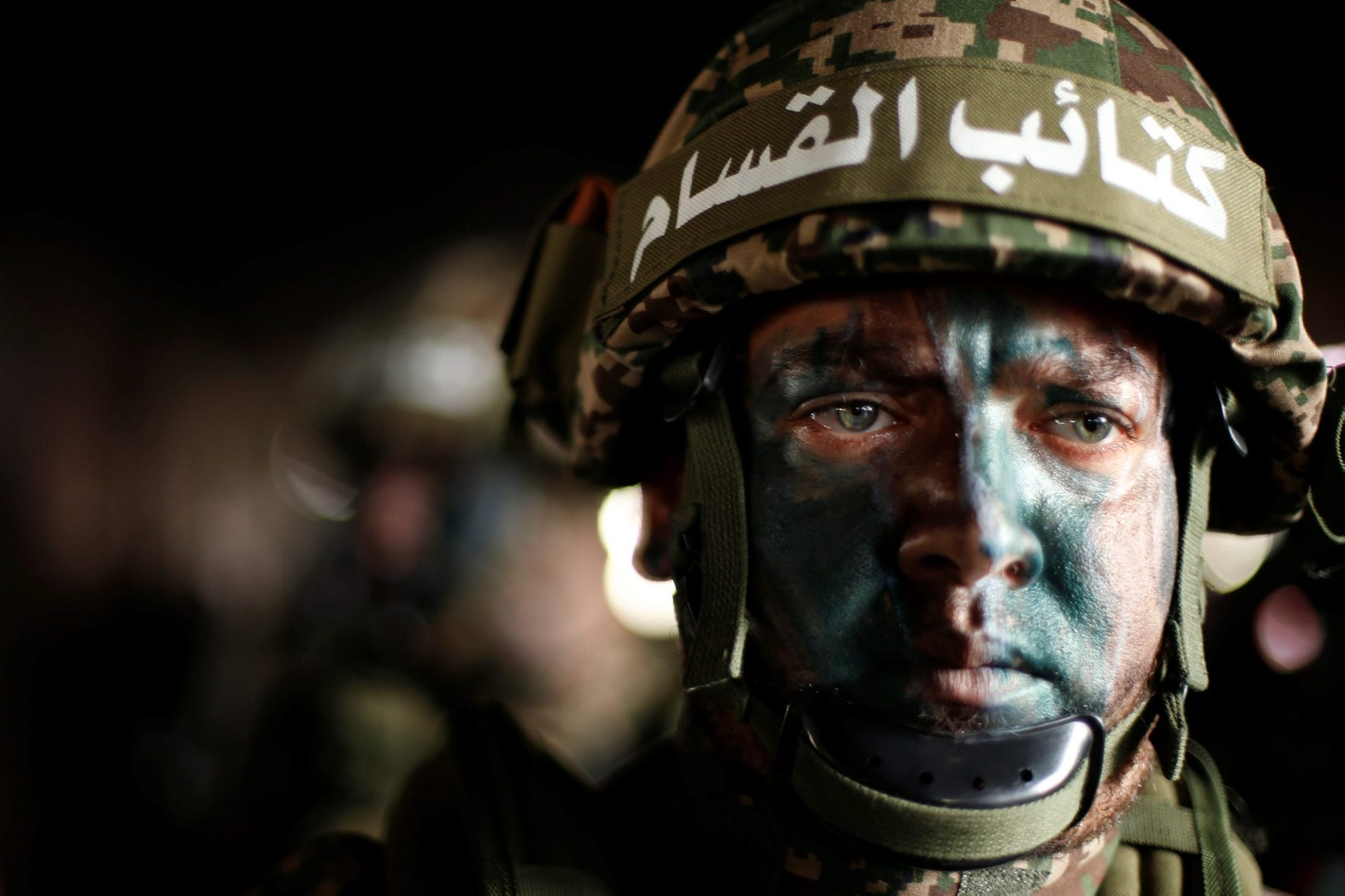 A Palestinian Hamas militant takes part in a rally marking the 30th anniversary of Hamas' founding, in Gaza City December 14, 2017.