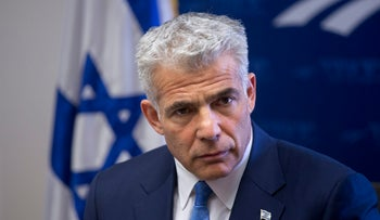 Yesh Atid leader Yair Lapid in the Knesset with members of his party, February 27, 2017.