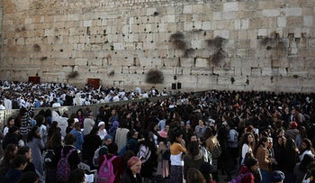 Jews attend prayers at the Western Wall plaza, Jerusalem, February 27, 2017.