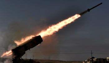 Iraqi troops fire a missile towards ISIS group fighters from the outskirts of Mosul as Iraqi forces battle against the group to recapture the west of the city on February 28, 2017.