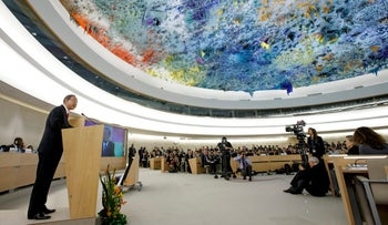 UN Secretary General Ban Ki-moon, left, delivers a speech during the opening of a high-level segment of the 25th session of the Human Rights Council, at the European headquarters of the United Nations, in Geneva, Switzerland, Monday, March 3, 2014.