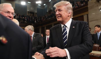 U.S. President Donald Trump shakes hands after delivering his first address to a joint session of Congress from the floor of the House of Representatives in Washington, U.S., February 28, 2017