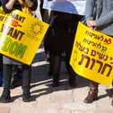 Women holding signs to protest on behalf of agunot, women whose husbands will not grant them a get in Jerusalem, January 8, 2017.