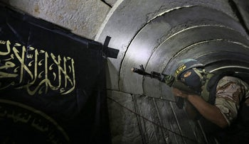 File photo taken on March 03, 2015 shows a Palestinian militant from the Islamic Jihad's armed wing, the Al-Quds Brigades, standing in a tunnel, used for storing weapons, as he takes part in military training in the south of the Gaza Strip.