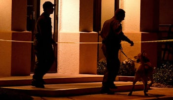 Las Vegas Metropolitan Police Department K-9 officers search the Jewish Community Center of Southern Nevada after an employee received a suspicious phone call that led about 10 people to evacuate the building on February 27, 2017 in Las Vegas, Nevada.