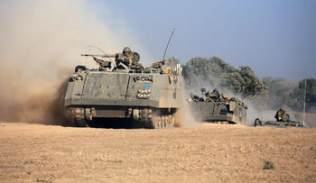 A convoy of Israeli armored personnel carrier tolls toward the Israel-Gaza border, July 20, 2014.