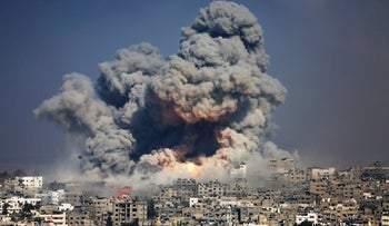 Smoke and fire from an Israeli strike rise over Gaza City, July 29, 2014.