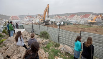 Israeli forces demolish houses built on private Palestinian land in the West Bank settlement of Ofra, March 1, 2017.