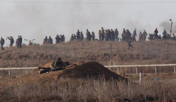 Israeli forces and Palestinian protesters clash on the Gaza border, December 15, 2017.
