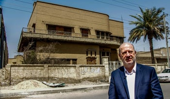 Edwin Shuker in front of his childhood home in Iraq, 2015.