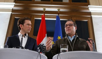 Heinz-Christian Strache (R) and Foreign Minister and leader of the Austrian People's Party Sebastian Kurz (L) after forming a new coalition government in Vienna, December 15, 2017.
