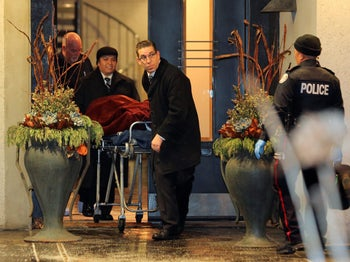 """A body removed from the home of Barry Sherman and his wife Honey, who were found dead under circumstances that police described as """"suspicious"""" in Toronto, Canada, December 15, 2017."""