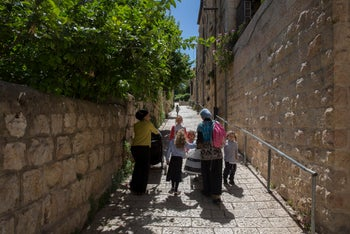 UPHILL STRUGGLE? Two ultra-Orthodox women and their children in the Jerusalem neighborhood of Musrara, May 2016.