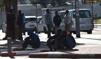African asylum seekers waiting for work on a street in south Tel Aviv, November 2017 (illustrative).
