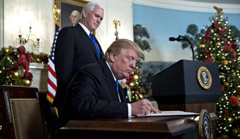 U.S. President Donald Trump signs a proclamation declaring Jerusalem as Israel's capitol as Vice President Mike Pence looks on. White House, Washington, D.C. Dec. 6, 2017