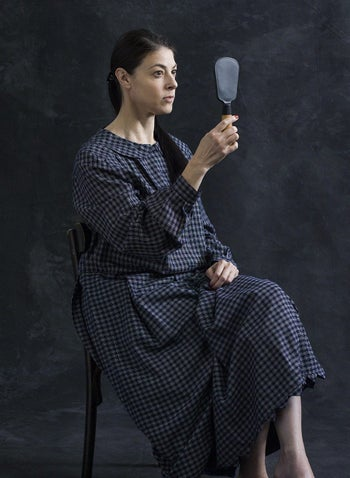 A photo by Michal Heiman of MK Merav Michaeli, wearing a dress made by the artist, based on a historical photograph.