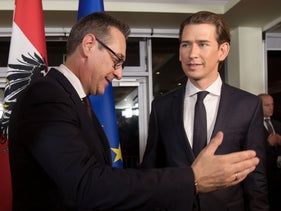Future Austrian Chancellor Sebastian Kurz (L) and incoming Vice Chancellor Heinz-Christian Strache of the far-right Freedom Party leave a press conference in Vienna, December 16, 2017.