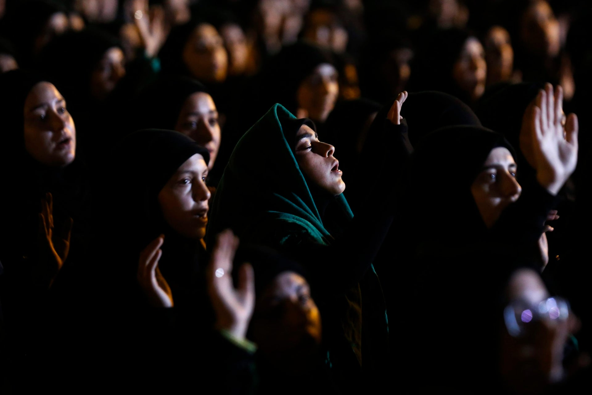 Hezbollah supporters listen to the story of Imam Hussein during activities to mark the ninth of Ashura, a 10-day ritual commemorating the death of Imam Hussein, in a southern suburb of Beirut, Lebanon, Saturday, Sept. 30, 2017.