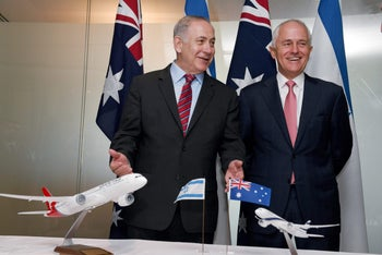 Israeli Prime Minister Benjamin Netanyahu and Australian Prime Minister Malcolm Turnbull share a laugh during the signing of agreements between the two countries in Sydney, Feb. 23, 2017.