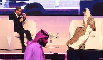 U.S. actor John Travolta (L) attends a panel discussion at the Apex Convention Center in the Saudi capital Riyadh on December 15, 2017