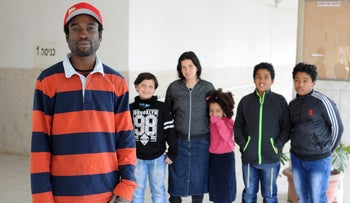 Martin Konadu and his family. 'It's like I don't belong anywhere, and this causes me much grief.'