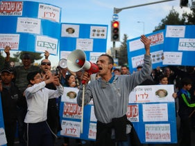 Workers protest outside the Teva Pharmaceutical Industries factory in Jerusalem, Sunday, Dec. 17, 2017