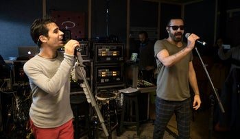 Iranian Shahin Najafi, right, and Israeli Aviv Geffen singers rehearse in Tel Aviv, Israel. Feb. 27, 2017.