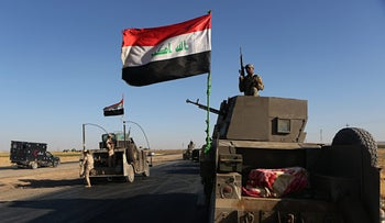 Federal Iraqi security forces gather outside the Kurdish hold City of Altun Kupri, outskirts of Irbil, Iraq on October 19, 2017