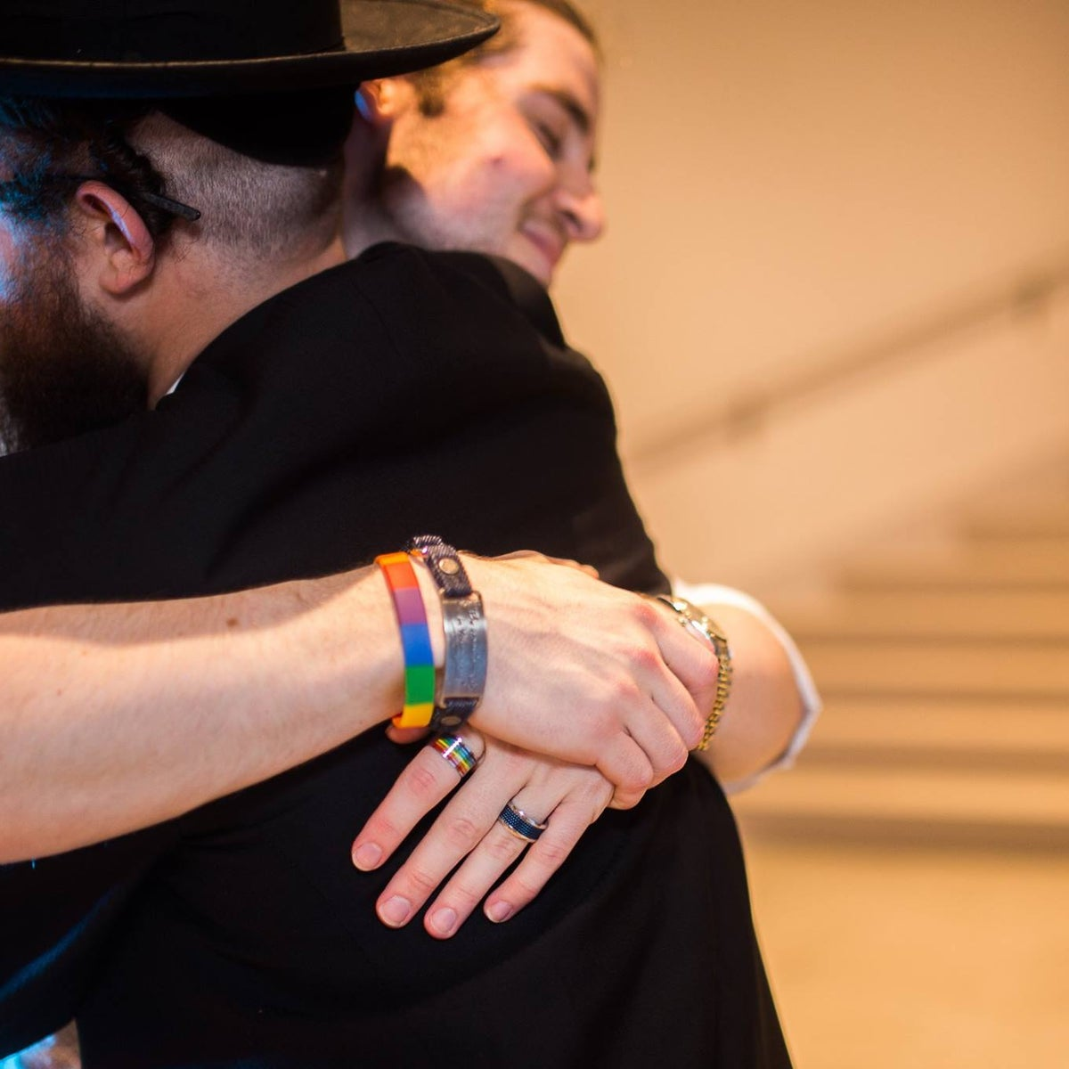 Gedalia Penner, right, hugging an ultra-Orthodox man at a Jewish Queer Youth event in New York.